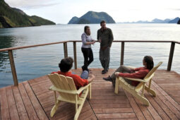 Travelers enjoy the deck at Orca Island Cabins in Resurrection Bay near Seward, Alaska July 2010.  (Model Release:  Seth Holden, Agnes Hage, Mark Betts, Shannon Faber)